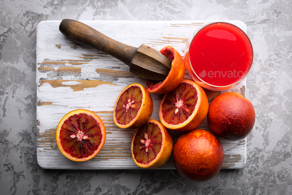 Red sicilian orange pieces on wooden board closeup - Stock Photo - Images