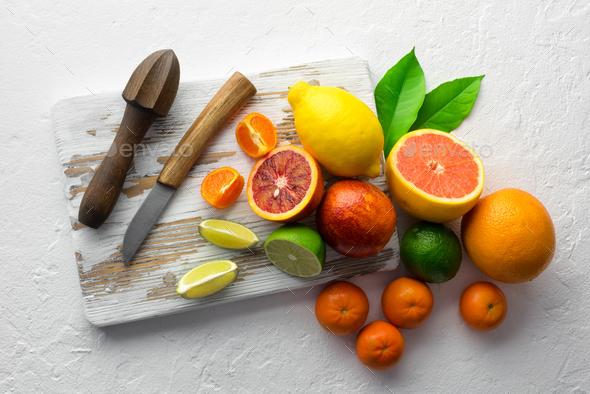 Mix of different citrus fruits closeup - Stock Photo - Images