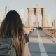 Young Woman with Backpack Walking Along Brooklyn Bridge - VideoHive Item for Sale