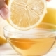 Video of Hand Slowly Dipping Lemon in Glass Jar with Honey - VideoHive Item for Sale