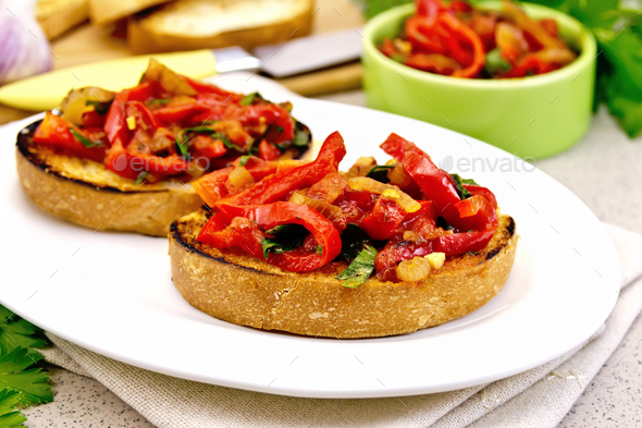 Bruschetta with vegetables in plate on granite table - Stock Photo - Images