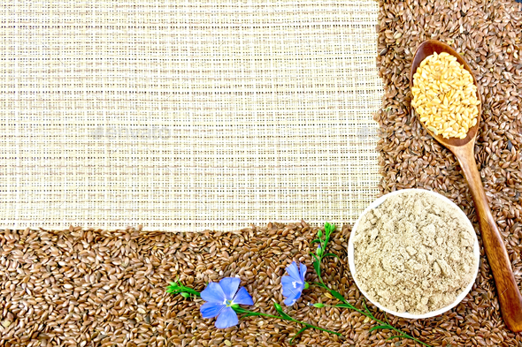 Flour and flax seeds with flowers on coarse woven fabric - Stock Photo - Images
