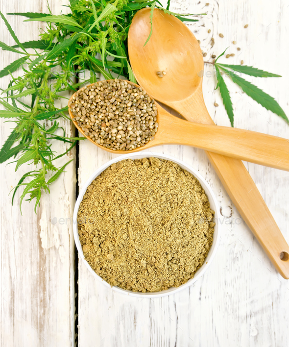 Flour hemp in bowl with spoons on light board top - Stock Photo - Images
