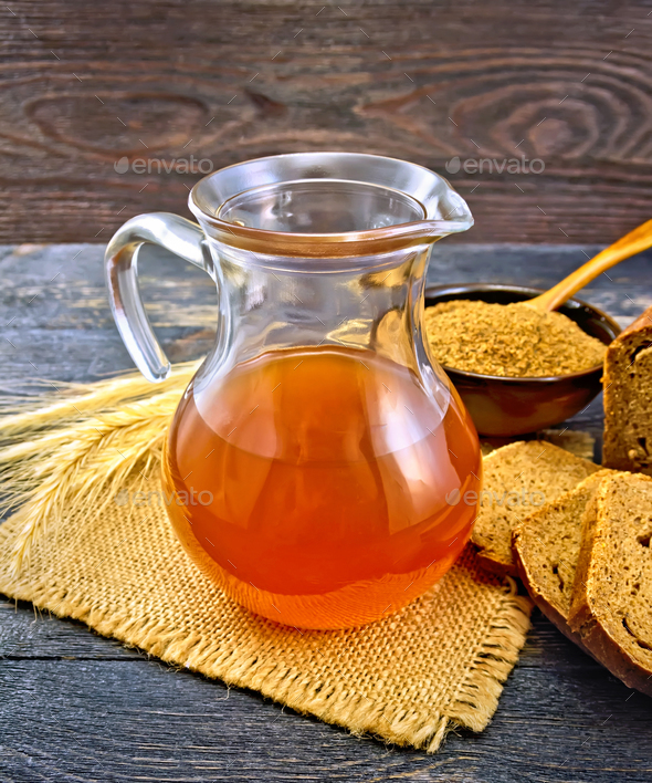 Kvass in glass jug on board - Stock Photo - Images