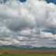 Fields and Storm Clouds Over Mountains - VideoHive Item for Sale