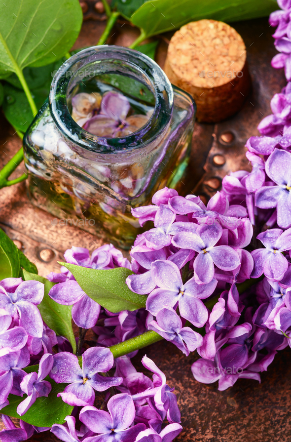 Organic essential aroma oil with lilac - Stock Photo - Images