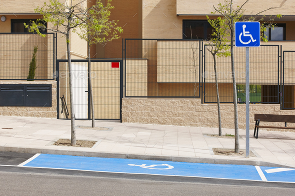 Restricted parking zone for disabled on a residencial urban area - Stock Photo - Images