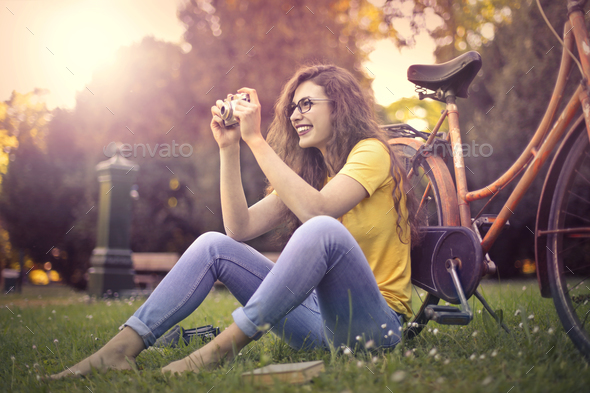 Girl sitting in a park - Stock Photo - Images