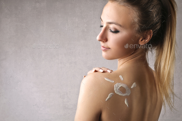 Portrait of a girl with a sun on her skin - Stock Photo - Images