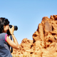 Female fit photographer takes pictures of rock formations. - PhotoDune Item for Sale