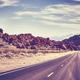 Retro toned desert road, travel concept. - PhotoDune Item for Sale
