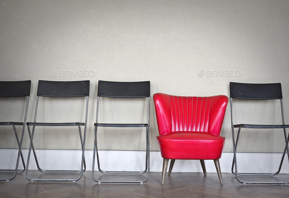 Armchair between chairs - Stock Photo - Images