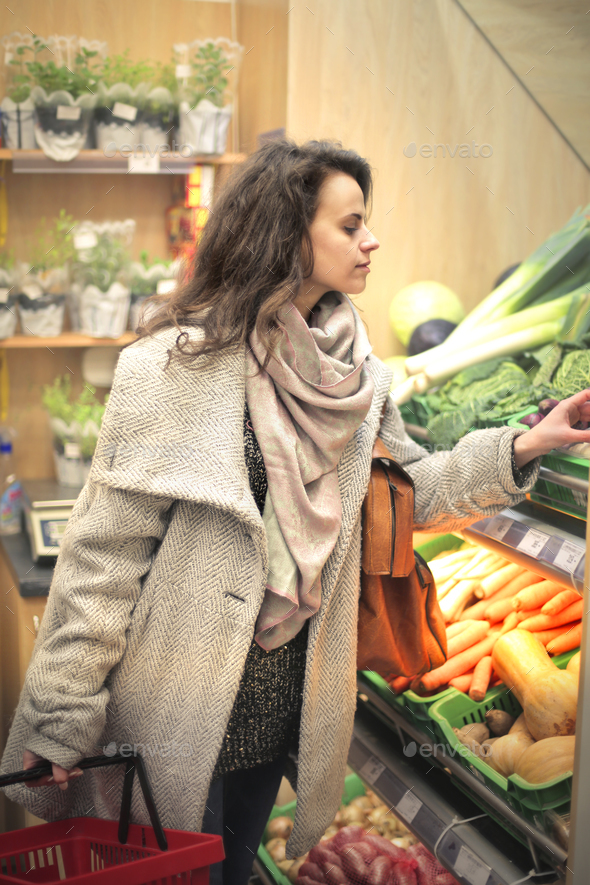 Woman in a supermarket - Stock Photo - Images