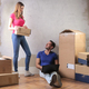 Couple with boxes in a new house - PhotoDune Item for Sale