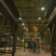 Man in Respirator Paints Metal Grid in Warehouse