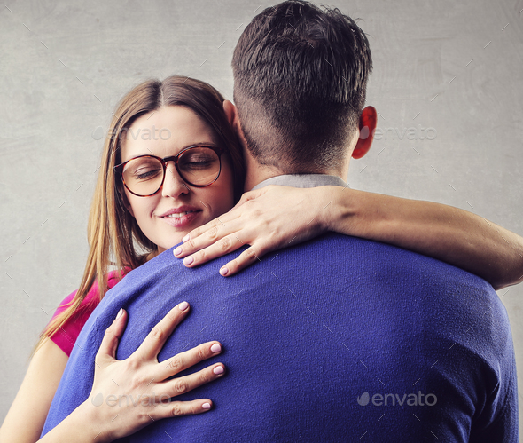 Man and woman hugging each other - Stock Photo - Images