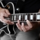 Musician Plays Solo on the Electric Guitar and Uses Tapping - VideoHive Item for Sale