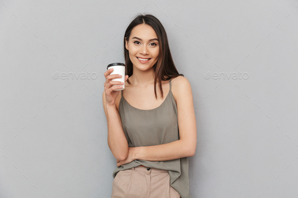 Portrait of a lovely asian woman take away coffee cup - Stock Photo - Images