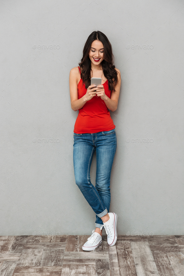 Full length image of Happy brunette woman in casual clothes - Stock Photo - Images
