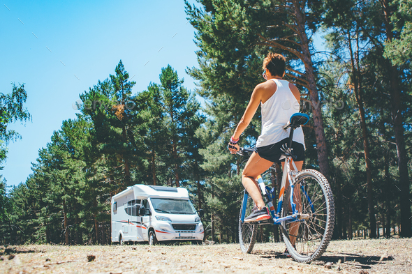 Motor home and girl with bicycle - Stock Photo - Images