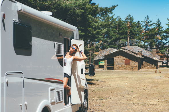 Happy girl relaxes on a motor home - Stock Photo - Images