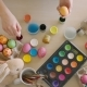 Woman Paints Rabbit on Colored Eggs at Easter Holiday - VideoHive Item for Sale
