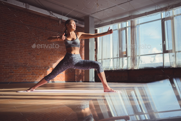 Young woman practicing gymnastics - Stock Photo - Images