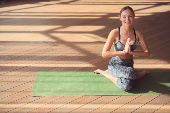 Smiling woman doing yoga - Stock Photo - Images