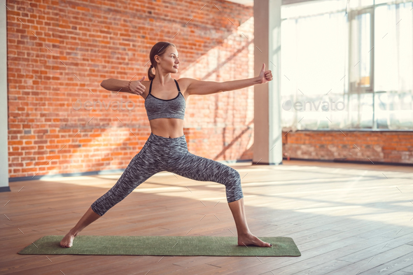 Young woman in yoga studio - Stock Photo - Images