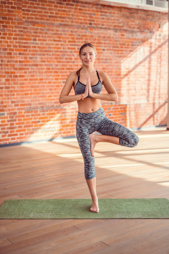 Attractive girl in yoga studio - Stock Photo - Images