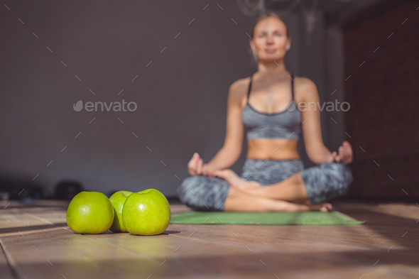 Young girl in a lotus in yoga class - Stock Photo - Images