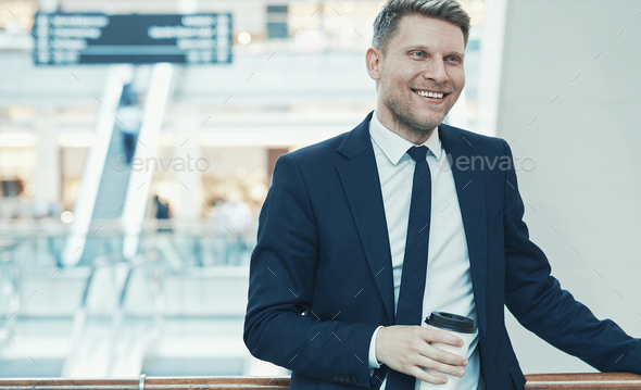 Smiling businessman with coffee - Stock Photo - Images