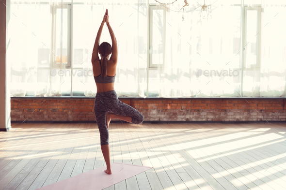 Young girl in yoga class - Stock Photo - Images