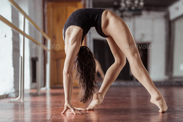 Active young woman in dance studio - Stock Photo - Images