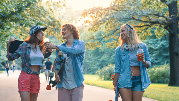 Young smiling people with skateboards - Stock Photo - Images