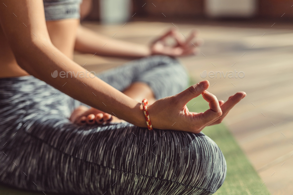 Young girl practicing mudra close-up - Stock Photo - Images