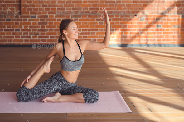 Young woman doing yoga indoors - Stock Photo - Images