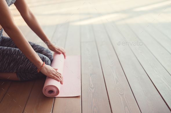 Young girl with a mat close-up - Stock Photo - Images