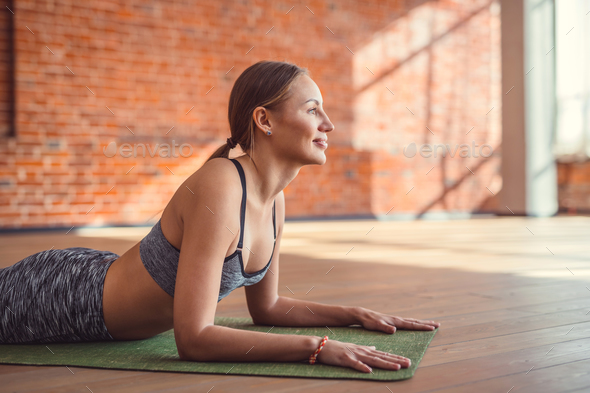 Smiling sport woman indoors - Stock Photo - Images