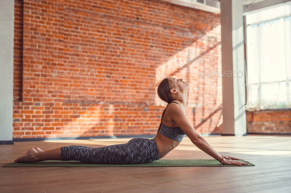 Young woman practicing pilates indoors - Stock Photo - Images