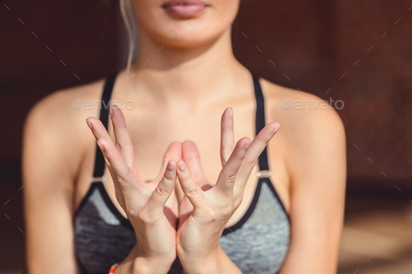 Young girl practicing mudra of yoga - Stock Photo - Images