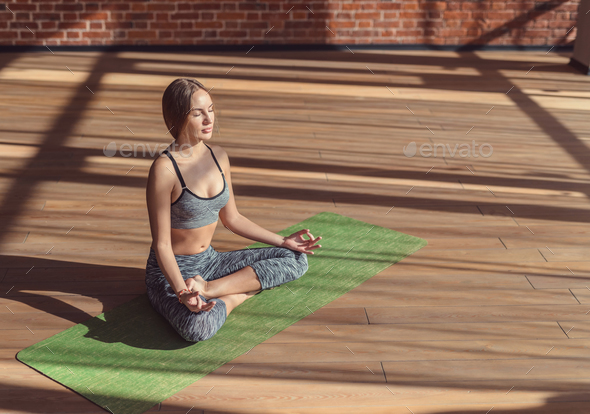 Young woman in a lotus position - Stock Photo - Images