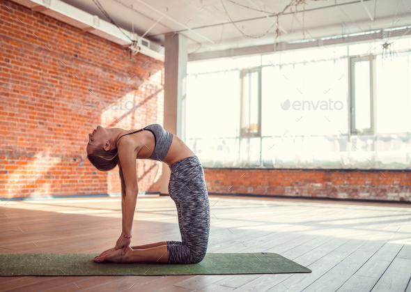 Young girl in yoga studio - Stock Photo - Images
