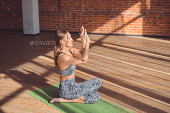 Young girl doing yoga indoors - Stock Photo - Images