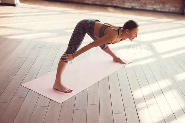 Young woman practicing yoga - Stock Photo - Images