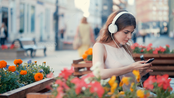 Young attractive girl listen to music - Stock Photo - Images