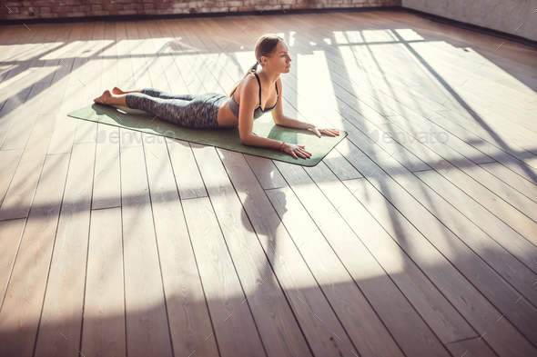 Young girl practicing yoga in the sunlight - Stock Photo - Images