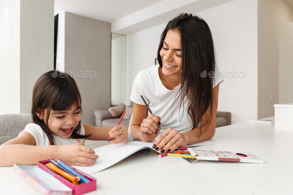 Portrait of young family mother and child spending time together - Stock Photo - Images
