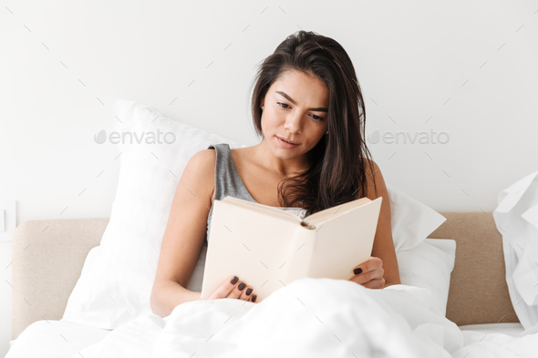 Portrait of relaxed adorable woman with long brown hair resting - Stock Photo - Images
