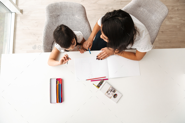 Image from above of young woman and little kid taking pleasure w - Stock Photo - Images